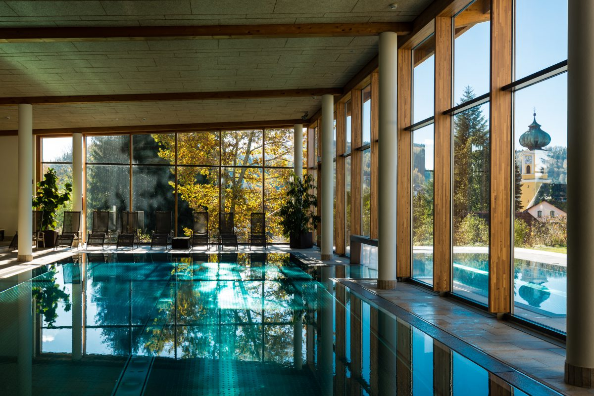 Wood Curtain Wall Around a Pool